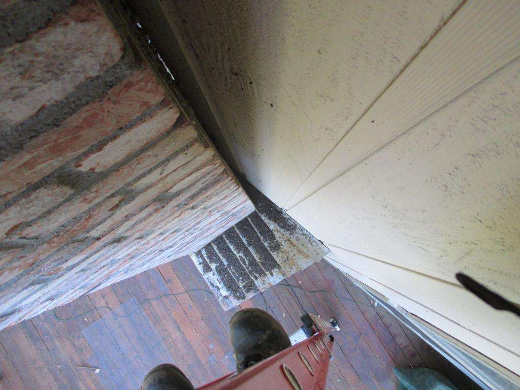 Looking down from the bat's access area. Lots of bat poop has accumulated.