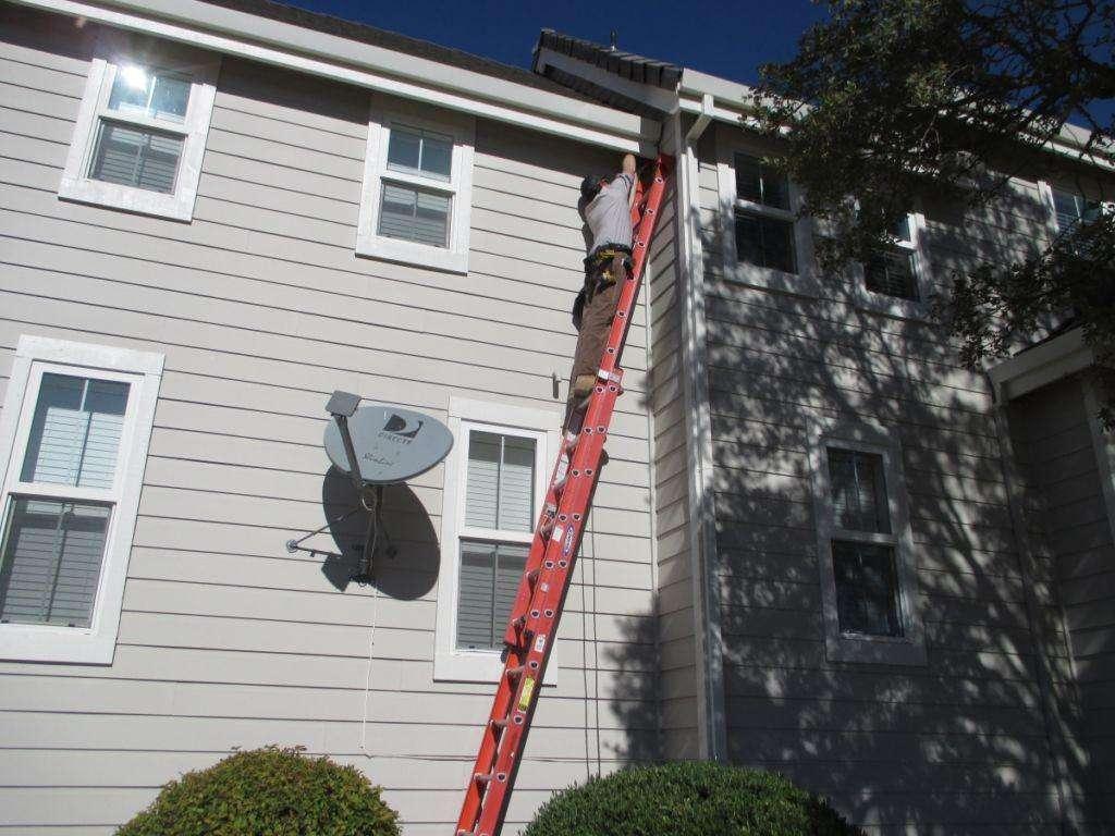 Dave Adragna installing bat exclusion hardware.