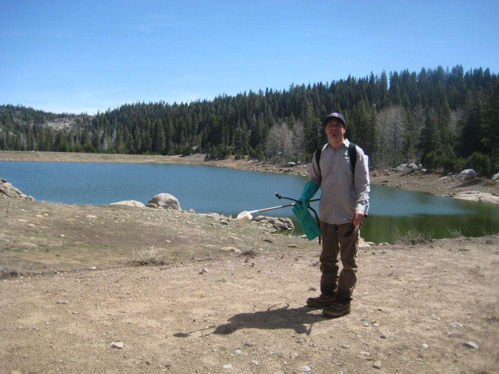 Don't swim in that lake! It is not a lake. Josh Esposito poses in front if the Bear Valley Sewage Treatment pond.